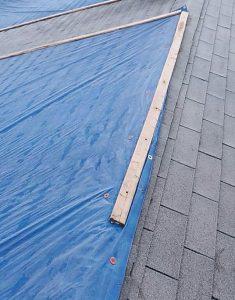 Tarp on roof